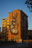 A building painted with a big wolf stock images