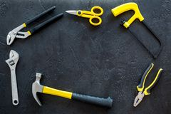 Building, painting and repair tools frame for house constructor work place set dark background top view space for text. Building, painting and repair tools frame Stock Image