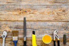 Building, painting and repair tools frame for house constructor work place set wooden background top view space for text. Building, painting and repair tools Royalty Free Stock Photography