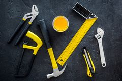 Building, painting and repair tools for house constructor work place set dark background top view pattern Stock Images