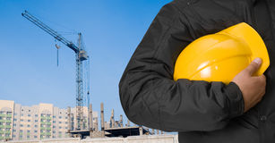 Building panorama. Builder with helmet on building panorama background Royalty Free Stock Image