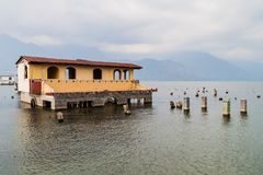 Building partially submerged because of rising level of Atitlan lake in San Pedro La Laguna village, Guatema. La royalty free stock image