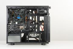 Building of PC, ATX motherboard inserted to black computer midi