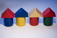 Building pieces. Wooden toy pieces as real estate concept Stock Image