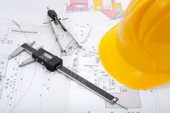Building plan. With safety helmet Stock Image