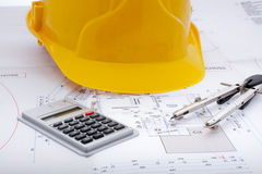 Building plan. With safety helmet Royalty Free Stock Images
