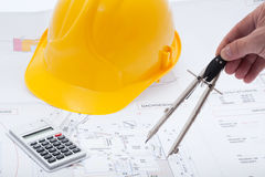 Building plan. With safety helmet Stock Photo