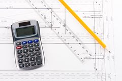 Building plan with calculator, ruler and pencil. Over white Stock Photography