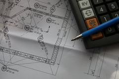 Building plan. German Building plan and calculator royalty free stock photography