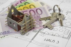 Building plan with keys and money Stock Photo