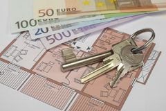 Building plan with keys and money Royalty Free Stock Image