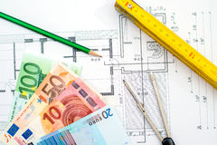 Building plan with money Royalty Free Stock Photo
