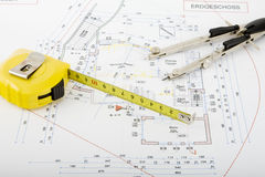 Building plan with pair of compasses and rolling m Stock Image