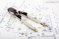 Building plan with pair of compasses and rolling m Royalty Free Stock Photo