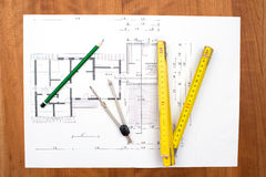 Building plan with pencil, folding yardstick and compass Royalty Free Stock Photos