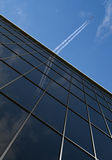 Building with plane. Office building with airplane and blue sky stock illustration