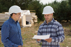 Building Planners Talking at the Construction Site Royalty Free Stock Images