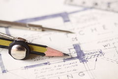 Building plans A. Photograph of building plans with a pencil, compass and ruler stock image