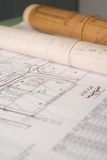 Building Plans. On draftsman's desk royalty free stock image