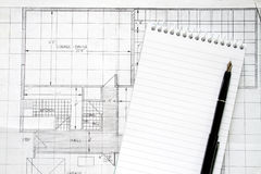 Building plans. A blank note pad and pen Royalty Free Stock Photo