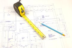 Building plans and tape measure. Set of building plans for a custom house with tape measure and pencil Stock Image