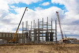 Building at plant. Construction of the industrial building against the cloudy sky Royalty Free Stock Photo