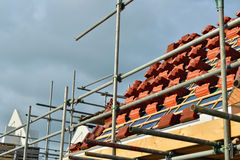 Building plot of new homes. Roof tiles for new homes Stock Photos
