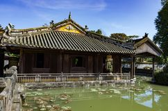 Building and pond inside the citadel of Hue, Vietnam. royalty free stock image