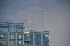 Building in Portland, Oregon w/ Windmills. This is a building in Portland, Oregon with windmills that generate electricity as `green` energy stock photos