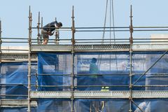 Building progress 159. At 47 Beane St. Gosford. December 2018. Gosford, New South Wales, Australia - December 1, 2018: Construction worker on new home units royalty free stock images