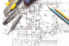 Building project. House blueprint with work tools, close-up royalty free stock images