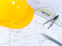 Building projects. With architect drawing and protective tools Royalty Free Stock Photo