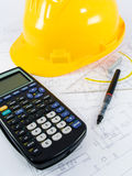 Building projects. With architect drawing and protective tools Stock Photos