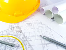Building projects. With architect drawing and protective tools Stock Image