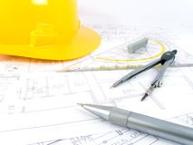 Building projects. With architect drawing and protective tools Royalty Free Stock Photography