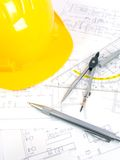 Building projects with architect drawing. And protective tools Stock Photo