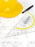 Building projects with architect drawing. And protective tools Royalty Free Stock Photo