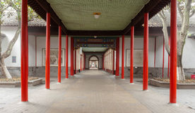 Building on the promenade and red pillars Stock Images