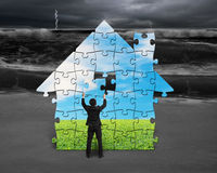 Building puzzles house. With beautiful landscape Royalty Free Stock Photography