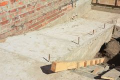 Building ramp for wheelchair entry and steps. Brick ramp way for support wheelchair disabled people in new house construction. Concrete ramp for wheelchair Stock Photo