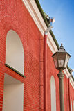 Building from a red brick and a lantern. Old building from a red brick and a lantern Stock Photo