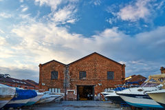 The building is of red brick, parking for boats. Royalty Free Stock Images