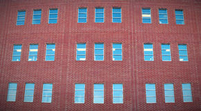 Building red bricks wall windows panoramic office exterior Royalty Free Stock Photography