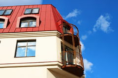 Building with a red roof and blue sky Royalty Free Stock Photos