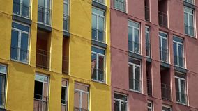 Building with red and yellow facades. New building with red and yellow facades stock footage