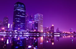 Building reflect water at night in Bangkok stock photo