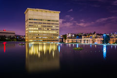 Building reflecting in a pool at night, in downtown Los Angeles  Stock Photos