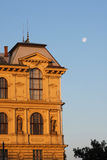 Building reflecting sunrise light. Building under a moonlight sky. Prague Stock Photography