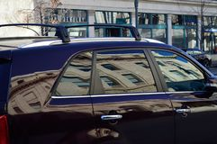 Building reflection in car windows royalty free stock photography