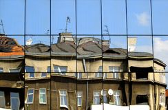 Building reflection in mirrors and deformity. In Poznan Stock Images